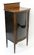 An Edwardian inlaid mahogany bow front display