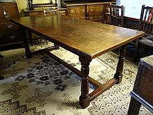 A Contemporary early 17thC style oak kitchen table