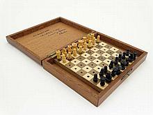 A miniature chess set , comprising 32 turned