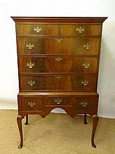 A Queen Anne style mahogany chest on stand having