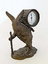 Novelty clock : An early 20thC cast bronze clock /