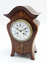 Mantle Clock : an inlaid Shaped Mahogany 8 day