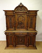 A French carved oak buffet with carved and column
