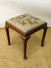 A 19thC mahogany four legged stool with