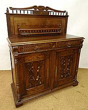 A 19thC French fruitwood buffet having carved fig