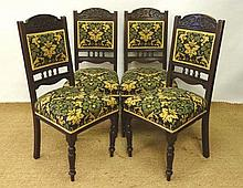 A set of 4 late Victorian walnut upholstered