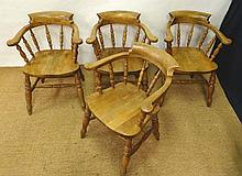 A set of 4 Victorian smokers bow open armchairs