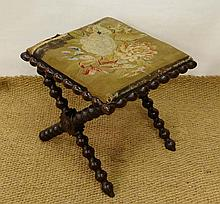 A Victorian X- frame stool with floral tapestry