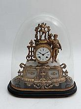 A French gilt metal mantle clock with glass dome