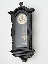 A Victorian Vienna wall clock with 8-day movement