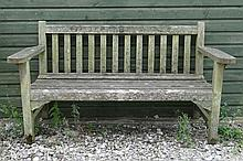 Royal Navy : A teak garden bench with brass plaque