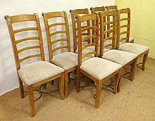 A set of 8 Contemporary Spanish satinwood and