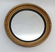 An early 20thC gilt gesso convex wall mirror in