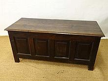 An 18thC four panel oak coffer with peg jointing