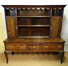 An early 19thC 3 drawer oak low dresser and plate
