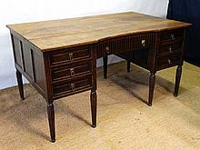 A c.1930 oak pedestal desk with reeded legs