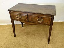 An 18thC oak 2 drawer side table standing on four