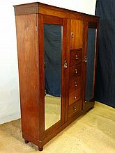 A late Victorian mahogany triple wardrobe with 2