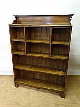 An Edwardian oak open front bookcase with cornice
