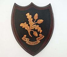 A c.1900 Shield shaped armorial depicting oak