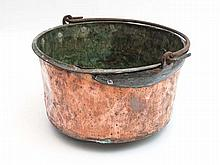 A 19thC large copper pot with wrought iron swing