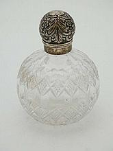 A Victorian cut glass scent bottle of spherical