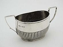 A silver 2-handled sugar bowl . Hallmarked