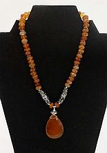 A silver necklace set with facet cut agate beads ,