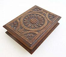 A late 19thC carved oak lidded card box, the lid