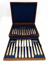 A cased 12-place silver plate set of fruit knives