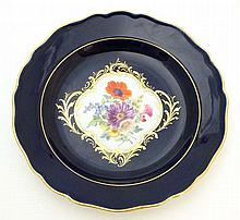 A Meissen porcelain dessert plate painted with