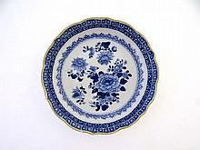 A 19thC blue & white saucer , painted with peony
