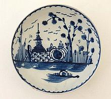 A c1800 pearlware saucer dish painted in blue with