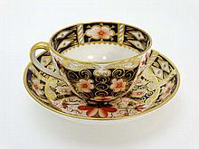 A Royal Crown Derby tea cup and saucer decorated