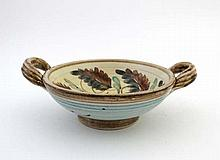 A 2 handled studio pottery bowl with hand painted