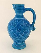 A 19th turquoise blue glazed ewer by Minton having