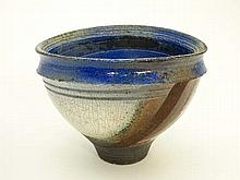 A studio bowl Raku fired stoneware decorated with
