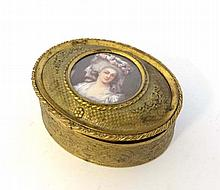 A French gilt brass oval jewellery box with cast