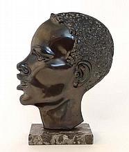 A painted bronze 2 dimensional image of an African