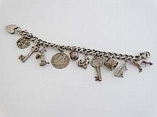 A silver charm bracelet set with 10 various silver