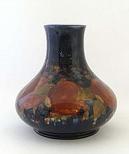 A William Moorcroft vase of squat shape with long