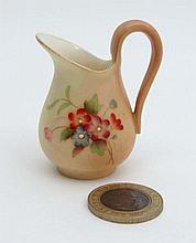 A Royal Worcester miniature jug painted with