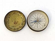 A Georgian turned brass pocket compass with paper