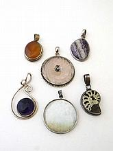 6 assorted silver pendants set with various