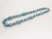 A necklace of graduated turquoise mottled