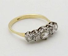 An 18ct gold ring set with 5 graduated diamonds in