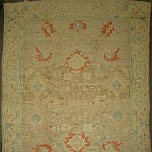 Oushak Carpet   Turkey, contemporary The allover pattern of polychrome floral vinery on the buff field is within a pale sa...