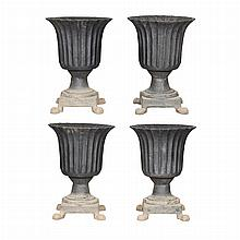 Group of Four Cast Iron Garden Urns