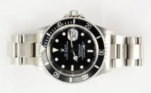 ROLEX OYSTER PERPETUAL DATE SUBMARINER SUPERLATIVE CHRONOMETER