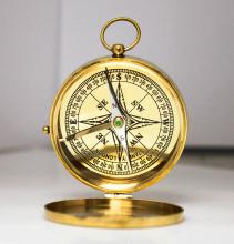 GOLD COLORED COMPASS